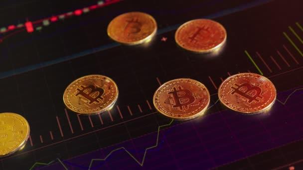 arany érme, bitcoins, a háttér világos pénzügyi grafika. üzleti grafikus közelről. Cryptocurrency. Virtuális valuta, nagy 4k.