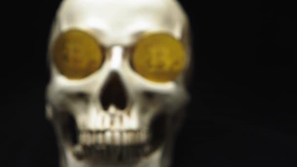Skull with bitcoin symbols