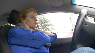 the driver of the woman fell asleep on the drivers seat on the side of the road. Waiting in the car.