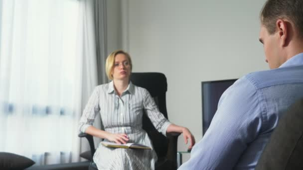 Medical concept with psychologist visit. woman psychologist gives psychological counseling to a young man