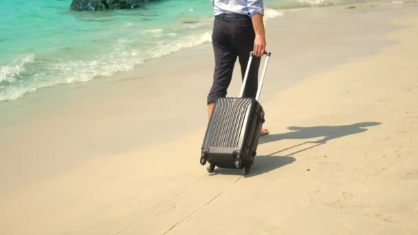 businessman with a suitcase goes on a white sandy beach. concept of freelancing, vacation