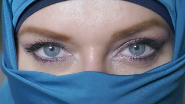 close-up. beautiful blue eyes of arab young woma in traditional islamic cloth niqab