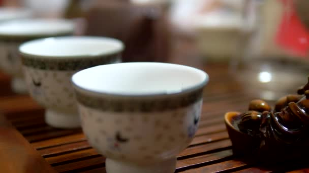 Traditional chinese tea ceremony. close-up. someone pours tea into cups