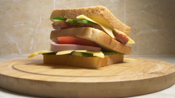 close up detail of homemade sandwich on wooden board