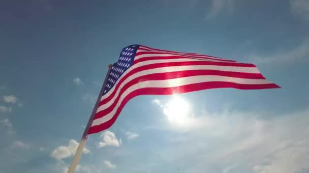 American flag waving in the blue sky