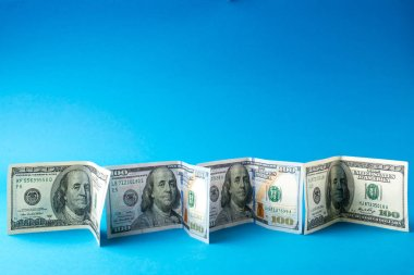 Dollar bills on a blue background stock vector