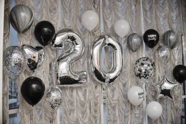 decorative air balloons in shape of number 20 for birthday party
