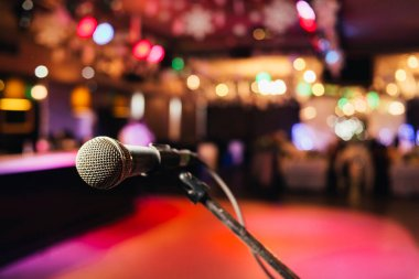 modern microphone for singing against beautiful blurry colored bokeh