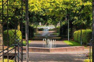 Small weir waterfall fountain in a public park