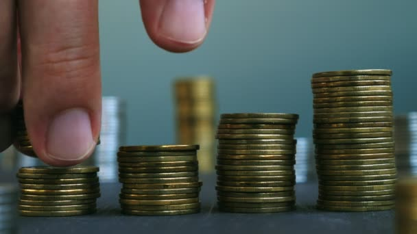 Man putting down coin on stacks of coins. Increase wealth and profit. Savings concept.