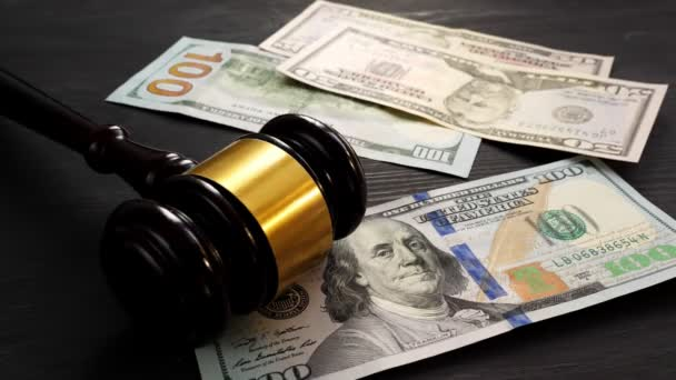 Bail bond and corruption concept. Gavel and money is dropping on a desk in a court.