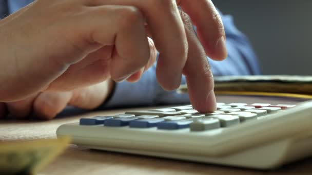 Hand counting on a calculator. Bookkeeping and accounting concept.