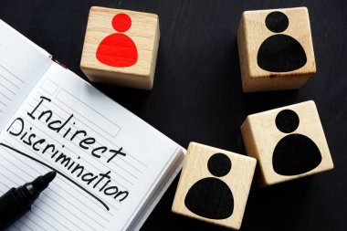 Indirect discrimination written in a note pad and cubes.