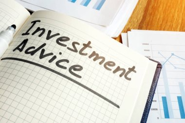 Investment advice handwritten sign in the note pad.