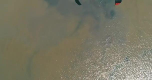 Kitesurfing in the Azov sea. Aerial 4k cinematic kite surfing top view
