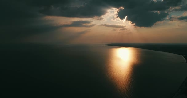 Golden sunrise with dramatic cloudscape over the sea video