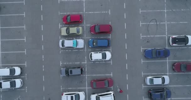 4k top aerial view of carpark with lots vacant space places traffic diagram.