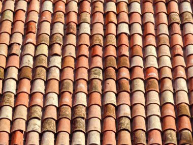 Red roof tiles on house as background image