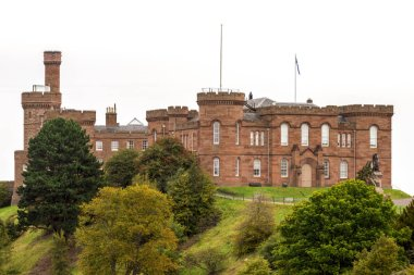 Scenic Inverness Castle with Flora Macdonad statue in the yard in one of the beautiful autumn days in Scotland