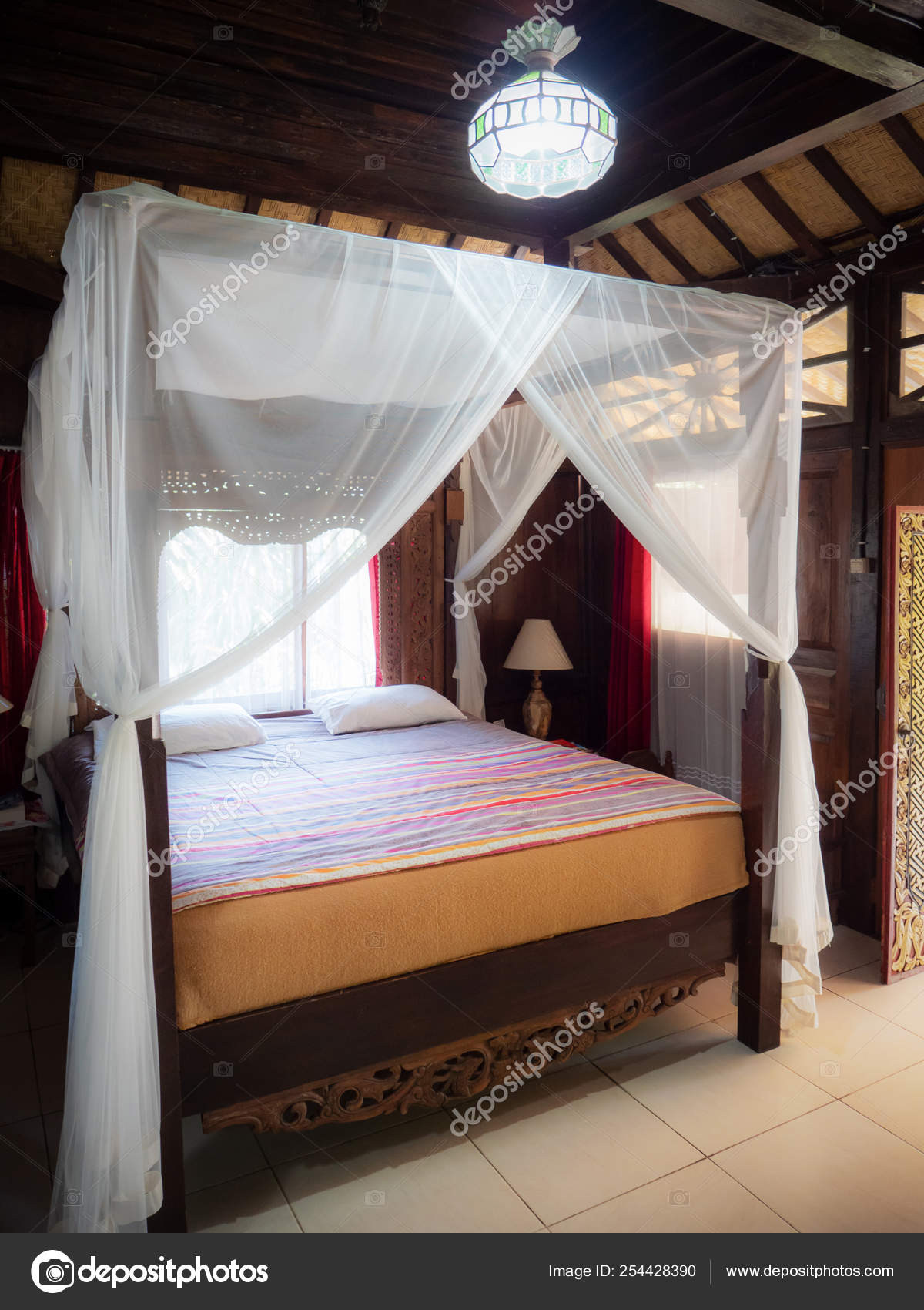 Picture of: Curtains Four Poster Bed Four Poster Bed With White Curtains In Indonesian Bungalow Stock Photo C Thakala 254428390
