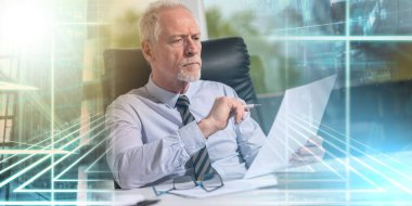 Portrait of mature businessman checking a document; multiple exp