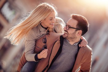 young couple having fun outdoors and smiling