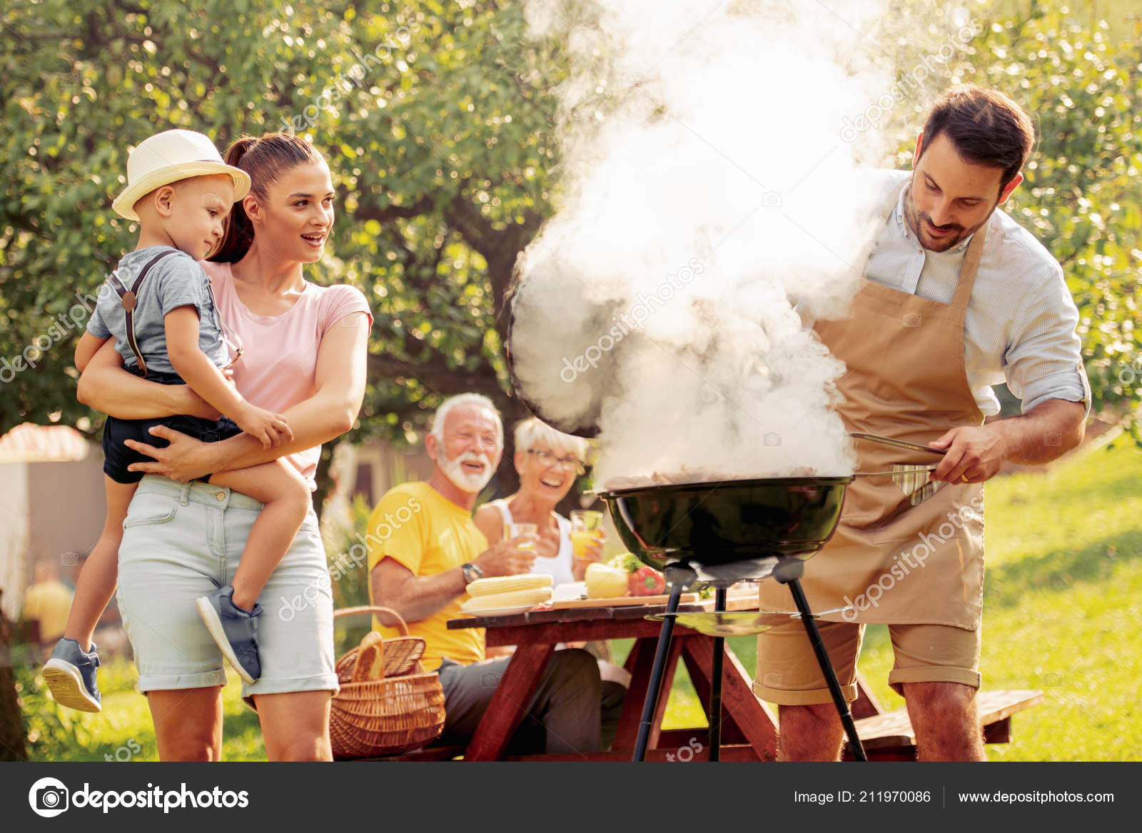 Happy Big Family Having Lunch Summer Garden Party People
