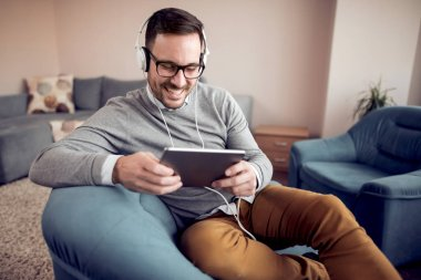 Man relaxing at home,listening to music.People,music,home and lifestyle concept.