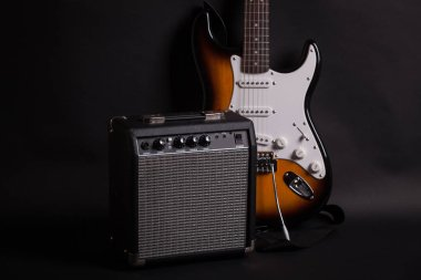 amplifier and electric guitar on dark background