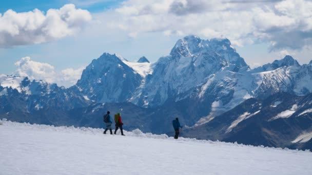 TERSKOL - SEPTEMBER 22, 2018: Scene with climbers going down the snow slope of the highest peak in Europe - mount Elbrus on september 22, 2018 in Terskol, Russia.