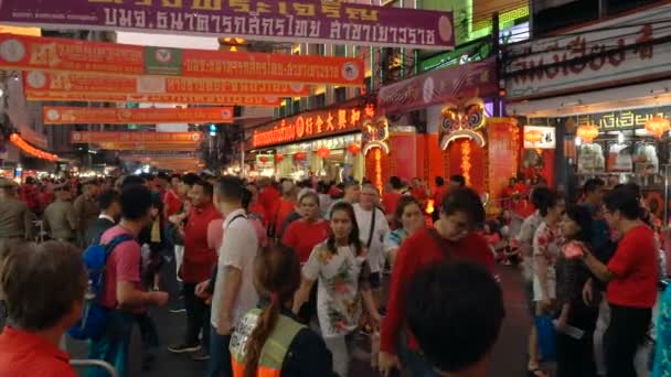 BANGKOK, THAILAND - FEBRUARY 05, 2019: Street scene with happy people celebrating Chinese New Year at China Town.