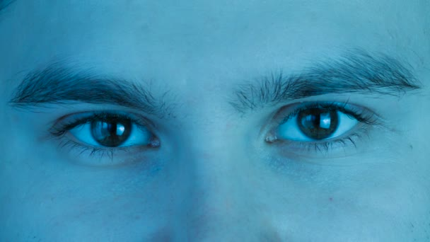 Close-up Macro shot of male Human brown eyes not blinking. Stylized blue cold tint color.