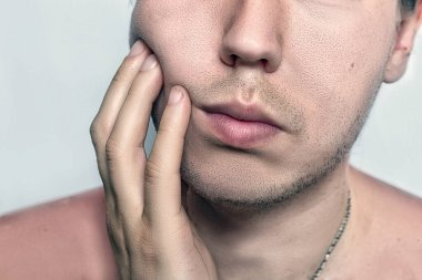 Shot of handsome attractive young caucasian male after shaving