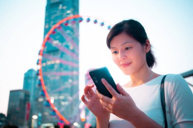 Young woman using smartphone in daily life