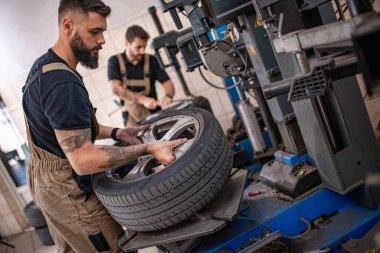 Mechanic in car service.Auto mechanic working in garage. stock vector