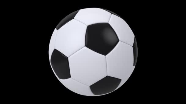 Realistický černobílý fotbalový míč izolovaný na černém pozadí. Animace 3D smyčky.