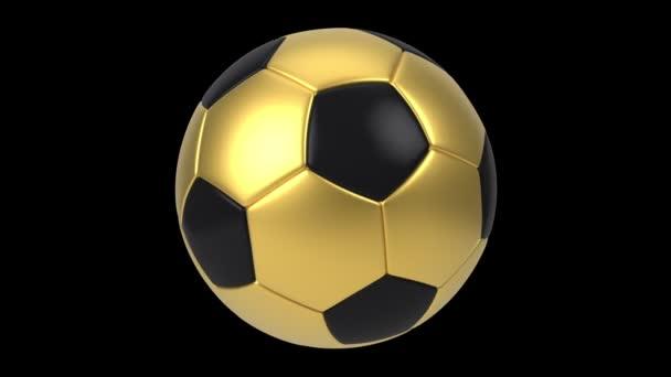 Realisztikus fekete és arany focilabda elszigetelt fekete háttérrel. 3D-s hurok animáció.