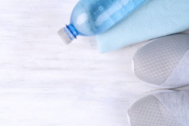 Shoes and water with set for sports activities. Fitness concept