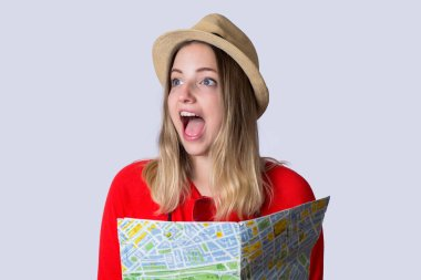 Young tourist woman with map.