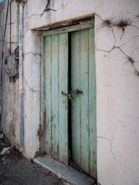 Old and dilapidated wooden door