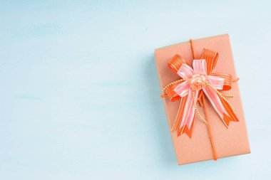 Gift box in hand on pink background for giving