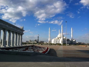 Hazret Sultan Mosque in the city of Nur Sultan. Beautiful white building of a mosque on a sunny day. Astana, Kazakhstan, mosque in city center, sunny weather, summer.