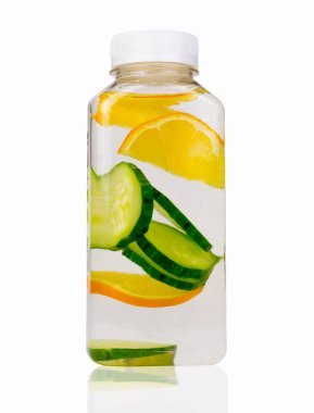 Lemonade made from cucumber slices and orange on a white background. An isolated object. Juice made of organic fruits and vegetables. Clean nutrition, healthy eating concept.