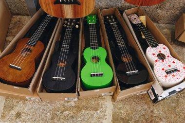PORTO, PORTUGAL - APRIL 29, 2016: Colorful ukuleles in box in music store