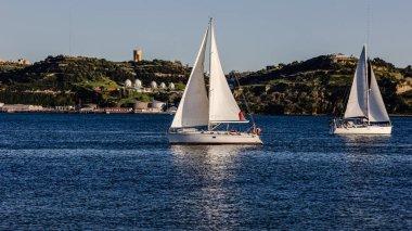 Sailing ship yachts with white sails, Lisbon, Portugal