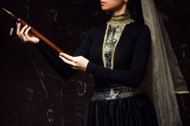 Young woman in armenian national dress with national musical instrument duduk in hands