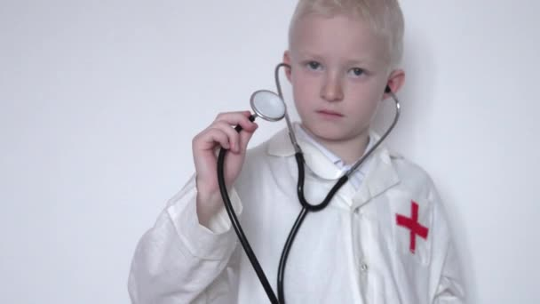 Closeup of a boy in a doctors suit with a stethoscope
