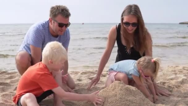 Family on the beach by the sea.
