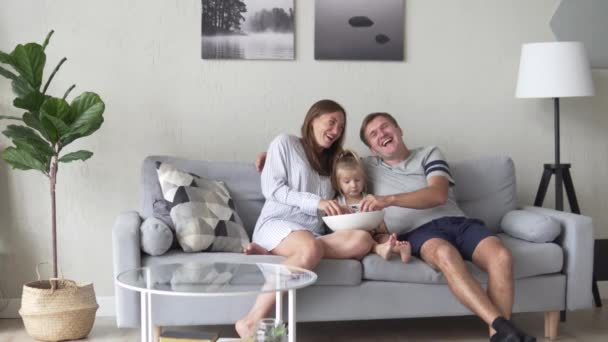 Dad, mom and daughter are sitting in the morning