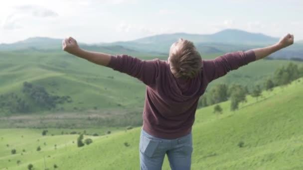 The unbridled joy of a male tourist on a hike